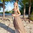 Stock Photo: Young womin long sundress on tropical beach. Polynesia. Island T