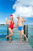 The man and the woman in New Year's suits on a beach. — Stock Photo
