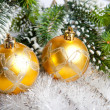 New Year's balls and snow-covered branches of a Christmas tree - Stockfoto