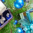 图库照片: Gift box with a necklace on a New Year tree