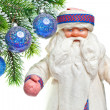 New Year's balls on a snow-covered branch and Santa Claus — Stock Photo
