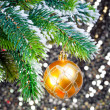 Yellow New Year's balls and snow-covered branches of a Christmas tree — Stock Photo #7683744