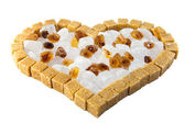 Heart from not refined reed granulated sugar — Stock Photo