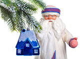 Father Frost (Santa Claus) and the toy house on a fur-tree - dream of own h — Stock Photo