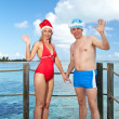 The man and the woman in New Year's suits on a beach — Stock Photo #7900967