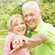 Smiling happy elderly couple — Stock Photo