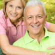 Happy mature woman embracing elderly man — Stock Photo