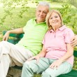 Stock Photo: Happy senior couple relaxed