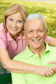 Happy mature woman embracing elderly man — Stock Photo