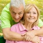 Portrait of happy senior couple outdoors — Stock Photo #7008831