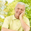 Portrait of happy senior man outdoors — Stock Photo