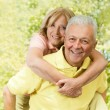 Royalty-Free Stock Photo: Happy senior man giving piggyback ride