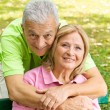 Happy elderly man embracing mature woman — Stock Photo #7553280