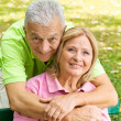 Stock Photo: Happy elderly man embracing mature woman