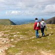 Stock Photo: Two hikers walking on Snowdonia, Wales, UK