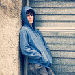 Royalty-Free Stock Photo: Boy in urban background, high contrast, cross process