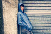 Boy in urban background, high contrast, cross process — Stock Photo