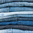 Stack of blue jeans background - Stock Photo