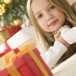 Stock Photo: Beautiful young blonde girl with cute red gift box. Christmas tr
