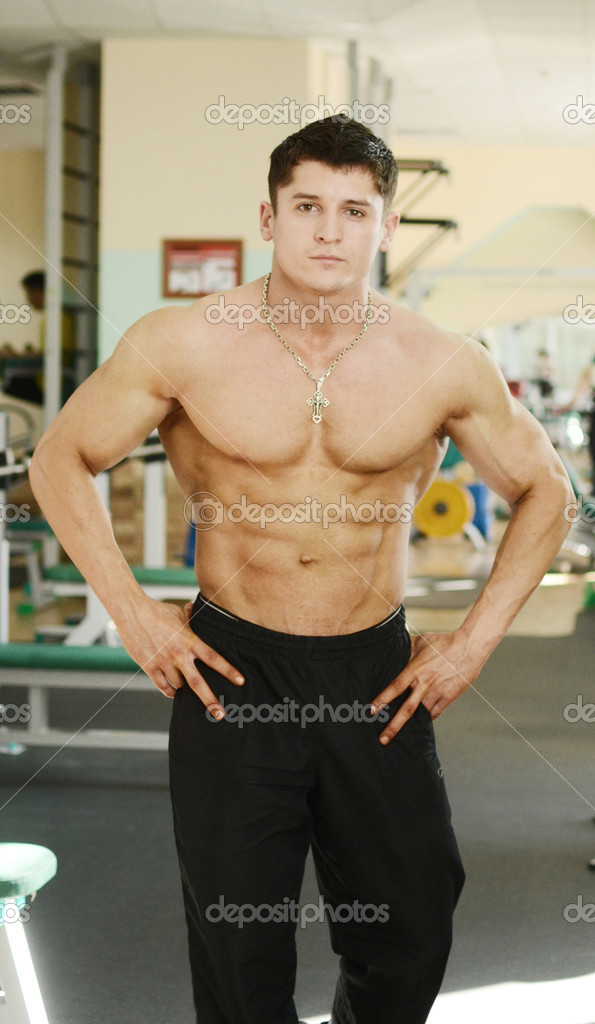 Muscular perfect male in gym centre  Stock Photo #7435101