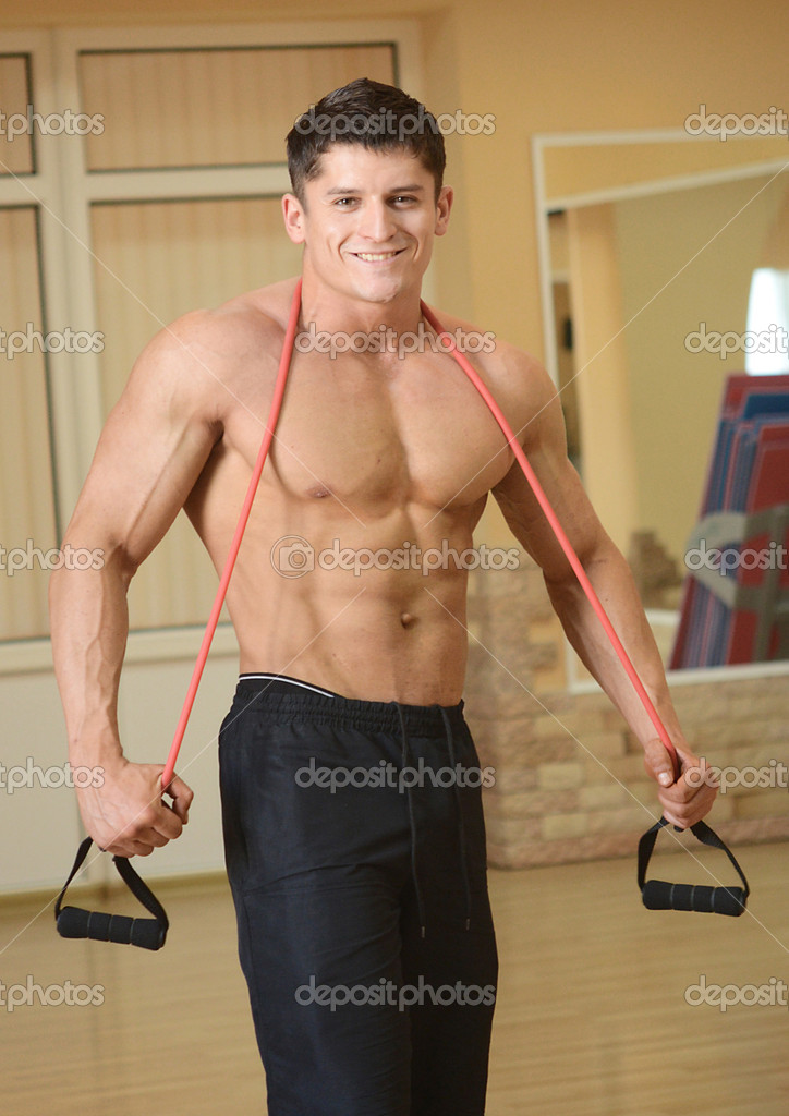 Muscular perfect male in a gym center — Stock Photo #7457254