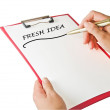 Writing fresh idea on clipboard — Stock Photo
