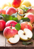 Red apples with leafs — Stock Photo