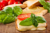 Toast with melted cheese — Stock Photo