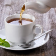Pouring tea into cup of tea — Stock Photo