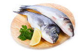 Sea bass with lemon and parsley — Stock Photo