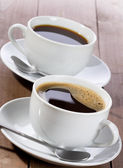 Cups of black coffee — Stock Photo
