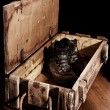 Army boots in old ammunition box — Stock Photo