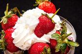 Close-up of strawberries in cream — Stock Photo