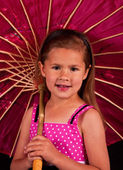 Small girl holding a umbrella — Foto Stock
