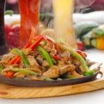 Original fajita sizzling hot on iron plate — Stock Photo