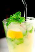 Mojito caipirina cocktail with fresh mint leaves — Stock Photo