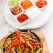Original fajita sizzling hot  on iron plate - Stock Photo