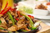 Original fajita sizzling hot on iron plate — 图库照片