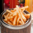 Fresh french fries on a bucket — Stock Photo