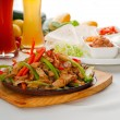 Original fajita sizzling hot on iron plate — Stock Photo #7583601