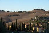 The hills around Pienza and Monticchiello just after sunrise. — Stock Photo