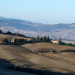 The hills around Pienza and Monticchiello  just after sunrise. - Stock Photo