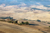 The hills around Pienza and Monticchiello just after sunrise. — Stock Photo