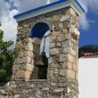 The bell tower at the Orthodox church in Zia. - Stock fotografie