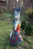 Hand-painted colourful bird of wood — Stock Photo