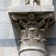 Pisa - capital of the column on the Baptistery - Stock Photo