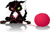 Kitten with a ball of thread — Stock Vector