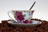 Coffe beans and cup — Stock Photo