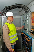 Electrician in switching power — Stock Photo
