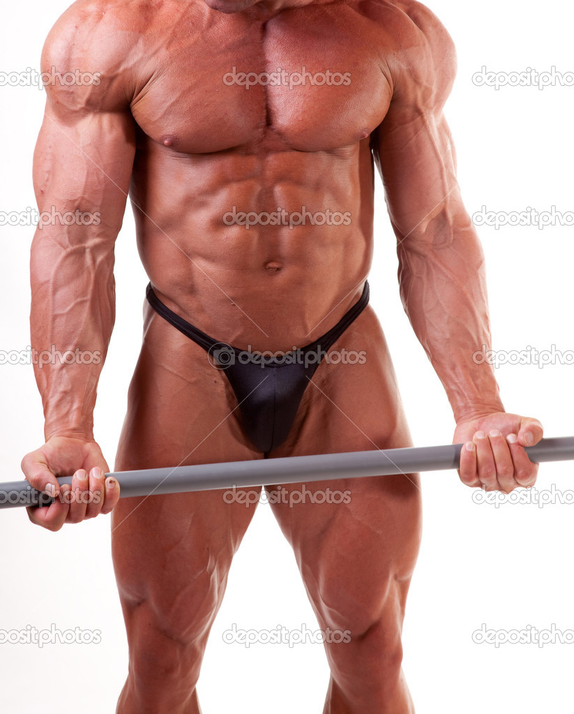 Bodybuilder exercising in front of white background  Stock Photo #6870021